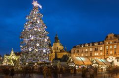 Prague Christmas market on the night in Old Town Square. Tyn Church, Bohemia. Blurred people on the move. Prague, Czech Republic. royalty free stock photos