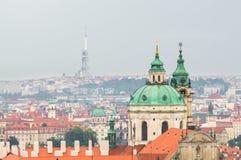 Prague Church of St. Nicholas, the TV tower Zizkov. Stock Photo