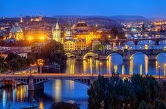 Prague city, bridges over Vltava river, Czech Republic. Prague city, Czech Republic, view of the bridges over Vltava river and the Old Town in blue evening light stock photos