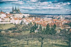 Prague city with castle from Petrin hill, Czech. Republic. Travel destination. Cultural heritage. Beautiful place. Old photo filter stock photo