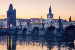 Prague city sunrise over Charles Bridge on Vltava river Stock Image