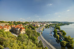 Prague cityscape in an afternoon sun with Vltava river flowing through the city center, Czech republic Stock Images
