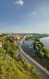 Prague cityscape in an afternoon sun with Vltava river flowing through the city center, Czech republic Royalty Free Stock Photography