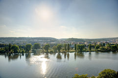 Prague cityscape in an afternoon sun with Vltava river flowing through the city center, Czech republic Royalty Free Stock Photos