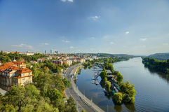 Prague cityscape in an afternoon sun with Vltava river flowing through the city center, Czech republic Royalty Free Stock Images