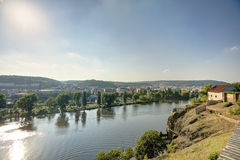 Prague cityscape in an afternoon sun with Vltava river flowing through the city center, Czech republic Stock Photography