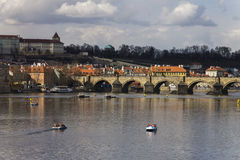 Prague cityscape with Charles bridge crossing the Vltava river Stock Images