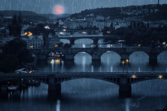 Prague cityscape and full moon at rainy night Royalty Free Stock Photo