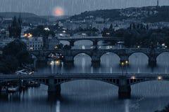 Prague cityscape and full moon at rainy night Stock Photography