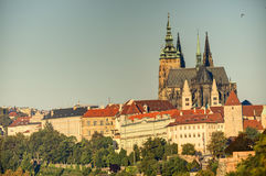 Prague cityscape with historic cityscape (Hradcany area) and the Prague castle during the morning sunrise Stock Photo