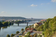 Prague cityscape in late afternoon sun with the Vltava river flowing through the heart of the city, Czech republic. Stock Images