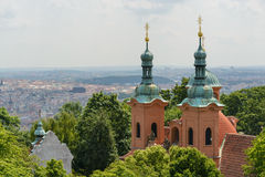 Prague cityscape. A view of the Prague from the Petrin Hill featuring the St. Lawrence church Stock Images
