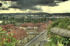 Prague clouds. Vysehrad view on the prague roof and dark clouds with sun shine Royalty Free Stock Photos