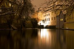 Prague creek Certovka at night. Certovka stram with a watermill wheel at night Royalty Free Stock Photos