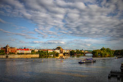 Prague. Waterfront of the Old Town of Prague and cruise ship sailing on the Vltava river royalty free stock photos
