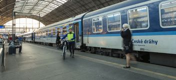 People boarding one of the blue trains of the national carrier in Czech republic, Ceske drahy, at the Prague main train station stock image