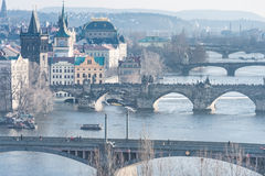 PRAGUE, CZECH - MARCH 14, 2016: Cityscape of Prague with Lvtana River and Charles Bridge. Flying Swan in Background Royalty Free Stock Image
