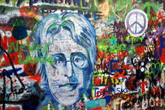 Prague, Czech Rep: John Lennon Memorial. A garden wall at the Priory of the Knights of Malta has been covered with grafitti featuring a portrait of slain rock Stock Photo