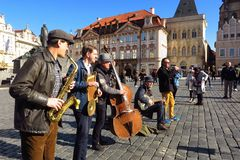 Prague Dixieland jazz band in Old Town Square. PRAGUE, CZECH REPUBLIC – FEBRUARY 27, 2017: A Dixieland jazz band plays in Prague's Old Town Square on a sunny Royalty Free Stock Images