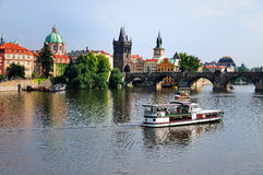 Prague, Czech Republic. A picture showing two boats on the Vltava river through Prague, the capital of the Czech Republic. The bridge across the river is the Royalty Free Stock Photo