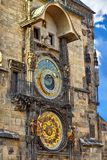 Prague, Czech Republic. Ancient astronomical clock. With calendar and statues on stone wall of tower of town hall. Famous touristic landmark in european capital royalty free stock photos