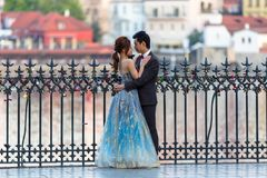 Free Prague, Czech Republic - April 20, 2019: Young Asian Couple At Wedding Photo Session At The Charles Bridge In Prague At Sunrise, Royalty Free Stock Photography - 158586387