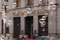 PRAGUE, CZECH REPUBLIC - APRIL 21, 2017: The building of the Czech National Bank, with colorful bubbles floating around Stock Image