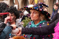 Costumed women in the streets of Prague during the carodejnice festival, or witch burning night royalty free stock photos