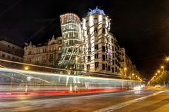 Prague, Czech Republic, April 22, 2019 - Dancing house in the evening, the lights of cars stock images