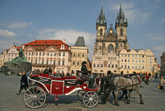 Horse Carriage waiting for tourists at the Old Square in Prague, Czech Republic. PRAGUE, CZECH REPUBLIC - APRIL 16, 2010: Horse Carriage waiting for tourists at Royalty Free Stock Photos