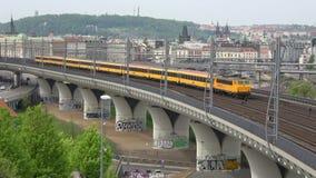 Passenger train transport company RegioJet on the railway overpass. Prague. Prague, Czech Republic - April 23, 2018: Passenger train transport company RegioJet stock video