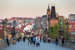 Prague, Czech Republic - April 20, 2019: People on the Charles bridge in Prague at sunrise, Czech Republic stock photo
