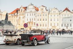 Red oldtimer car on the street of old Prague Royalty Free Stock Photo