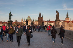 PRAGUE, CZECH REPUBLIC - APRIL 24, 2017: Tourists on the Charles Bridge, with towers of the Old Town in the background Stock Image