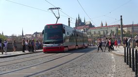 The tram passes through the Manesov bridge. Prague, Czech Republic. PRAGUE, CZECH REPUBLIC - APRIL 21, 2018: The tram passes through the Manesov bridge stock video
