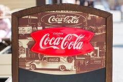 Prague, Czech Republic - April, 2018: Vintage Coca Cola advertisement sign in Prague, Czech Republic. The most famous carbonated s stock image