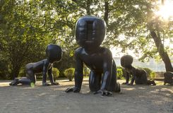 Baby statues by David Cerny in Kampa Park, Prague. Prague, Czech Republic - Aug 21 2018: Photo of three bronze baby statues by David Cerny in Kampa Park. Close royalty free stock photos