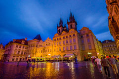 Prague, Czech Republic - 13 August, 2015: Beautiful building facade evening with church towers peeking up from behind Royalty Free Stock Images