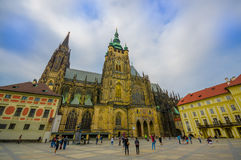 Prague, Czech Republic - 13 August, 2015: Beautiful St. Vitus cathedral as seen from street level, profile angle Stock Photos