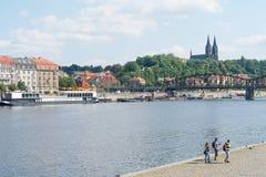 Characteristic architecture and tourist boats alongside promenad. PRAGUE, CZECH REPUBLIC - AUGUST 29, 2017; Characteristic architecture and tourist boats Royalty Free Stock Photo