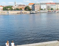 Characteristic architecture and tourist boats alongside promenad. PRAGUE, CZECH REPUBLIC - AUGUST 29, 2017; Characteristic architecture and tourist boats Royalty Free Stock Image
