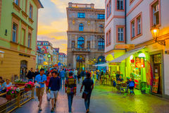 Prague, Czech Republic - 13 August, 2015: Charming city streets sorrounded by beautiful buildings seen from street level Stock Photos