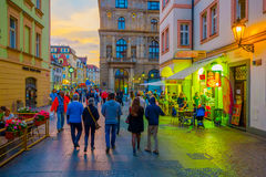 Prague, Czech Republic - 13 August, 2015: Charming city streets sorrounded by beautiful buildings seen from street level Royalty Free Stock Photos
