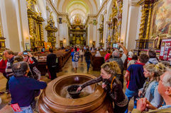 Prague, Czech Republic - 13 August, 2015: Inside amazing church of Castle Cathedral with massive water fountain and Stock Image