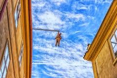 Prague, Czech Republic - August 17, 2018: Man Hanging out Sculpt royalty free stock image