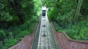 Prague, Czech Republic, 2017: Funicular. PRAGUE, CZECH REPUBLIC - AUGUST 2017: Moving trains on Petrin hill funicular, a funicular railway in the Czech capital stock footage
