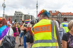 Prague, Czech Republic - August 11, 2018: People at the annual Prague Gay Pride parade. Photographer in a crowd stock photography