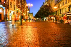 Prague streets at night golden glow of street lights. Stock Image