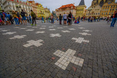 Prague, Czech Republic - 13 August, 2015: Steet view from lively and beautiful old town square, pattern of white crosses Royalty Free Stock Photography