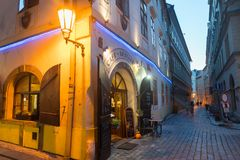 Street corner under glow of lamp and entrance to restaurant. PRAGUE, CZECH REPUBLIC,- 29 AUGUST 29, 2017; Street corner under glow of lamp and entrance to Royalty Free Stock Photography
